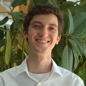 Male NAU student wearing a white button-down shirt