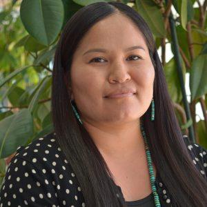 NAU female graduate student with long black hair and a black polka dot shirt