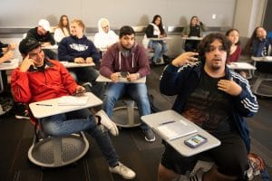 NAU100 students discussing in class.
