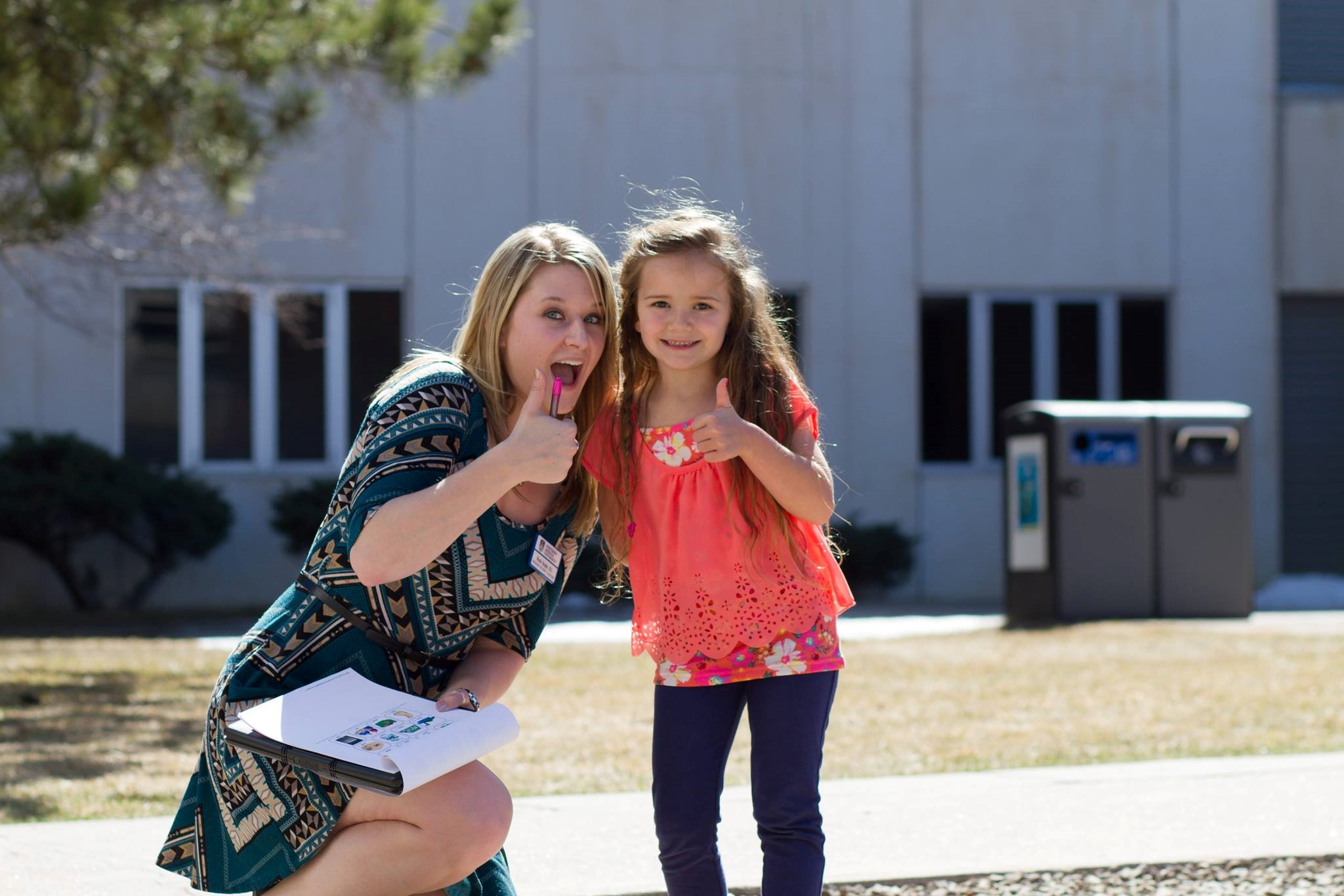 Thumbs up - Student and child