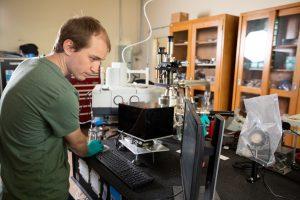 Mitchell Magnuson work in the PEAXS lab