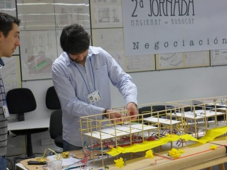 An NAU professor is working with a building model of small scale