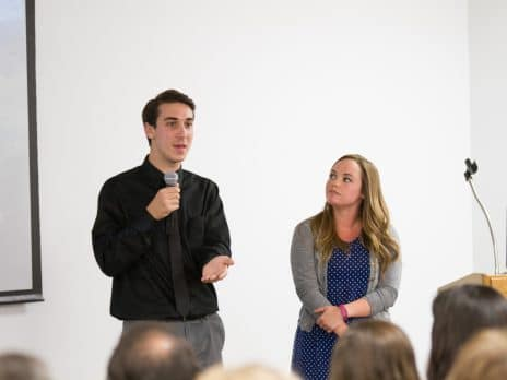 Two NAU students are presenting to an audience