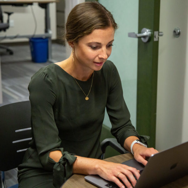 Taylor Lane works on a laptop