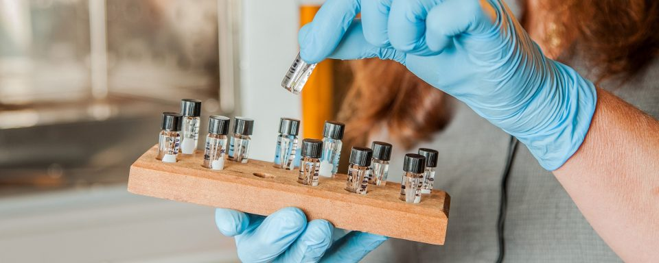 vials being held by student