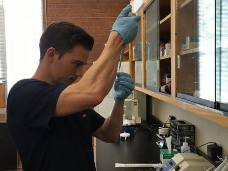 male nau cefns student working on research in a lab