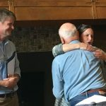 professors hug over Dr. Scott's retirement