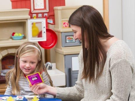 communication sciences and disorders student works with child