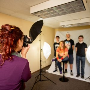 Group of students shooting photos in the Cline Library Photography Studio
