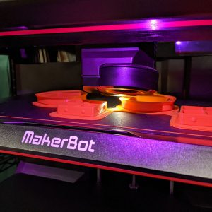 Objects being 3D printed using MakerBot Replicator printers at the Cline Library MakerLab