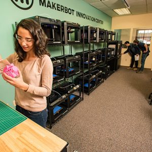 NAU student in the Cline Library MakerLab working on her 3D design