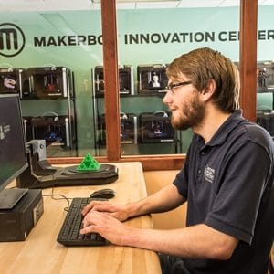 NAU student in the MakerLab editing his 3D design