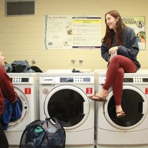 allen laundry room with students talking and doing laundry