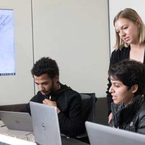 Students looking at laptop