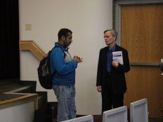 Tony Gibson talking to student