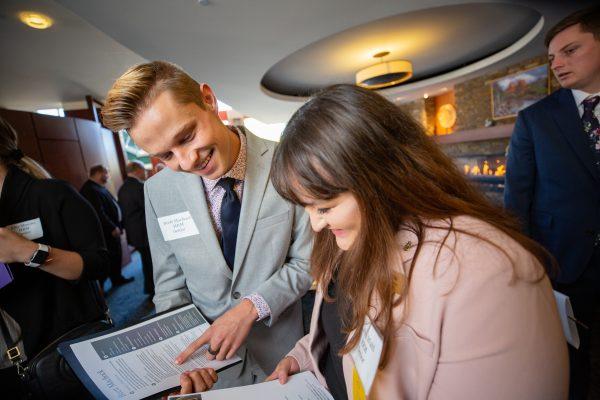 Students reviewing resumes at a career fair