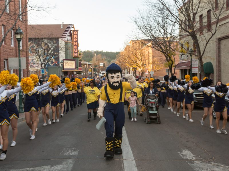 Louie the Lumberjack leads the pep rally parade for Northern Arizona University's homecoming game.