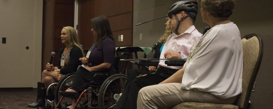 A panel of presenters discuss issues in disability.