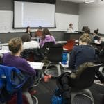 Dr. Katherine Mahoksy, Instructor Matthew Wangeman and his re-voicer lead the disability minor class