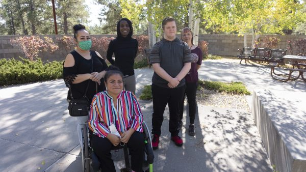 IHD staff member Sakénya McDonald meeting with students Leyevsca Santos Espinoza and Jacob Alexander (and their mothers/guardians) for their monthly coaching sessions at Coconino Community College
