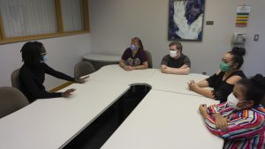 Students with their parents sit in a coaching session with masks