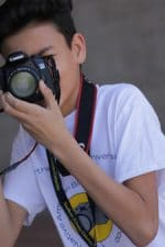 male student taking picture