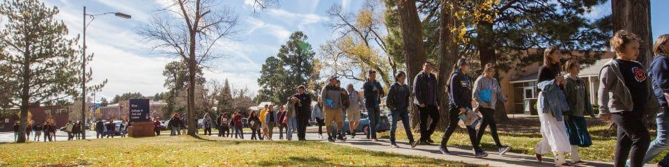 nau ses students walking through campus