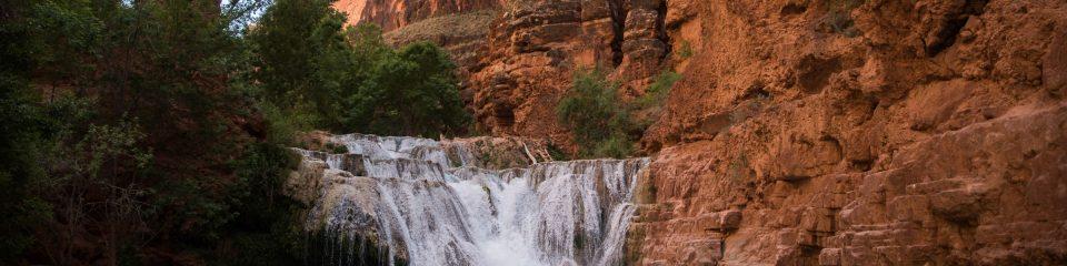nau students study geochemistry near a waterfall