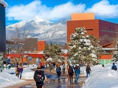 nau ses students walk to class in winter
