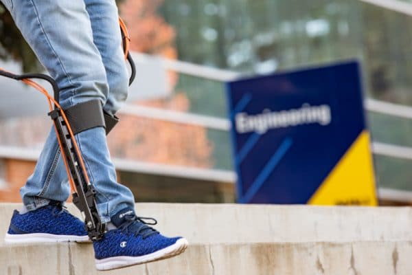 Zach Lerner exoskeleton outside of Engineering building