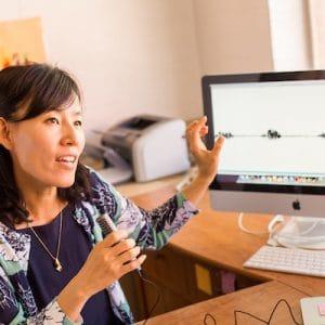 Okim Kang showing speech pattern on computer monitor
