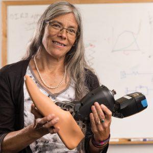 Kiisa Nishikawa holding prosthetic foot that uses her invention