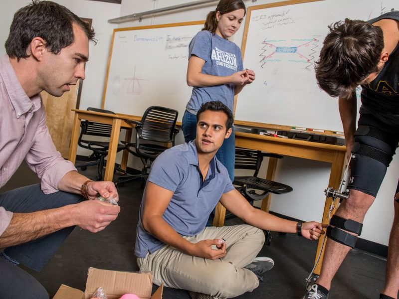 Zach Lerner and student researchers discussing exoskeleton project