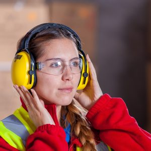 Women with ear and eye protection for working safely