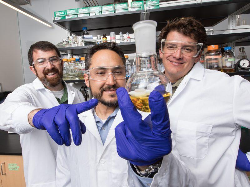 Robert Kellar, Nathan Nieto, Andy Koppisch in lab with their invention