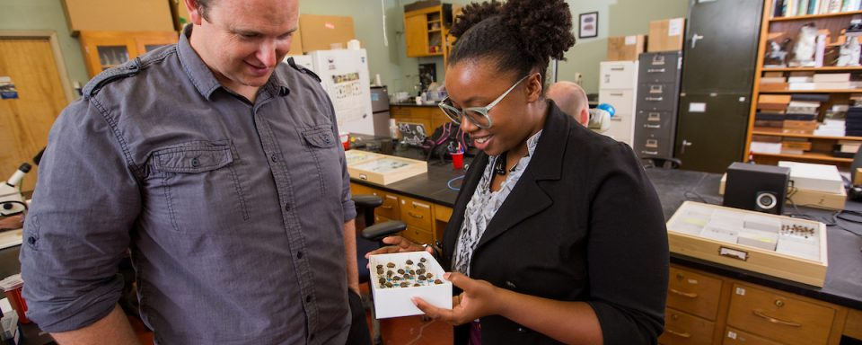 Aaron Smith discussing beetles with his student
