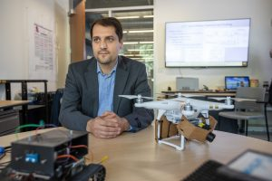 Abolfazl Razi in front of a drone