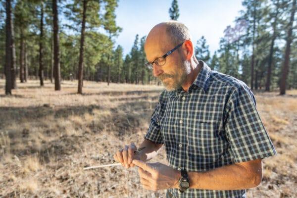 Peter Fule holding tree core sample