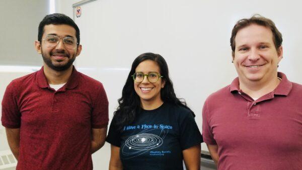Group photo of Ahmed AlHantoobi, NAU postdoctoral scholar Jennifer Buz and NAU assistant professor Christopher Edwards
