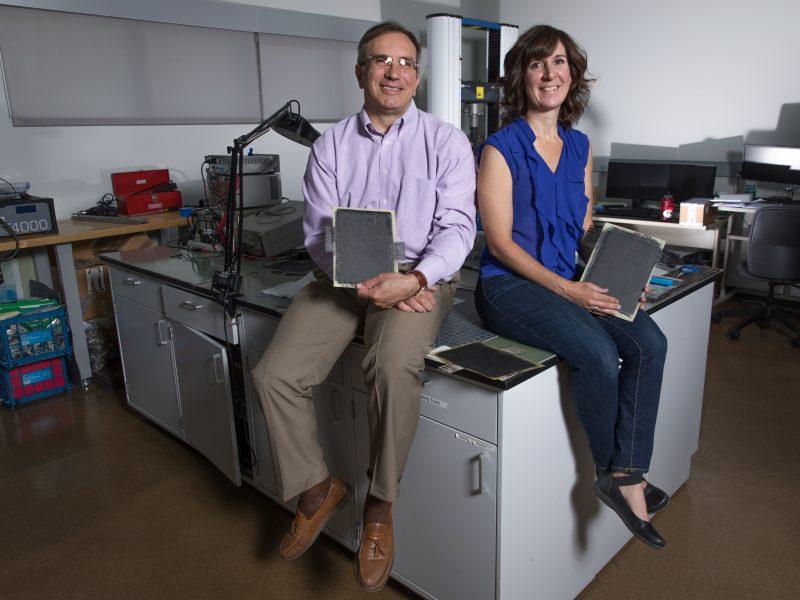 Constantin Ciocanel and Cindy Browder holding super capacitors
