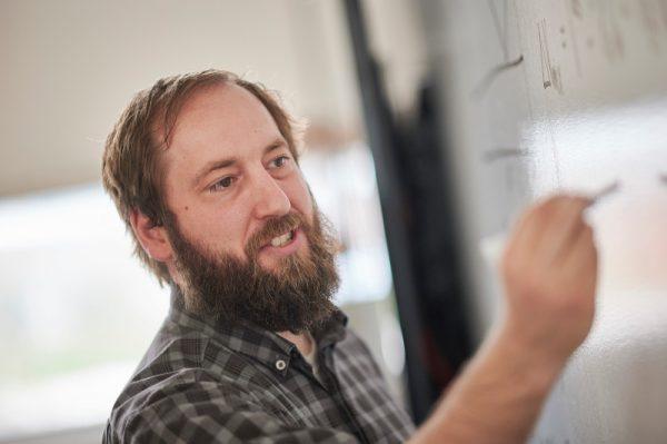 Gerrick Lindberg writing on a whiteboard