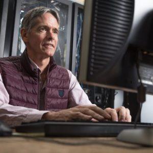 Scott Goetz processing data on a computer