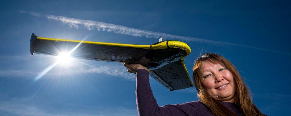 Teki Sankey holding a drone.