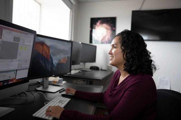 Cristina Thomas sitting as a computer