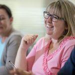 Educators smiling in a classroom