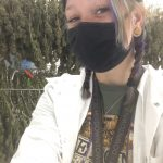 Victoria stands in front of cannabis at her new job