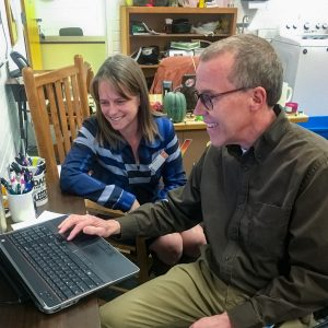 researchers at NAU sit over computer