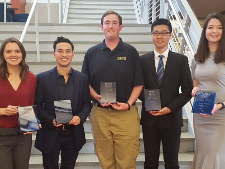 Five seniors students standing with awards in front of staircase