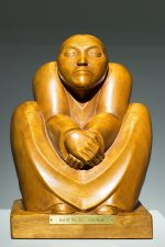 wooden sculpture, End of the Day, by John Rood.