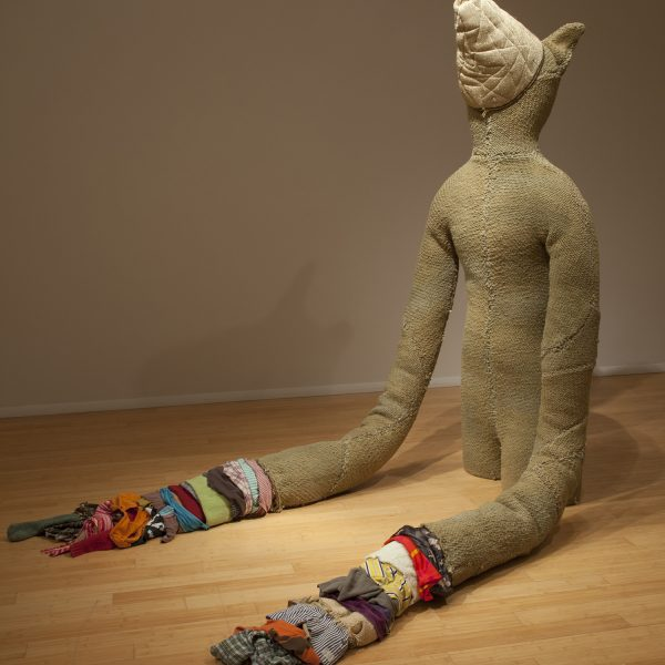Transformer. A soft sculpture, anamorphic in form made from handwoven fabric, steel, zippers